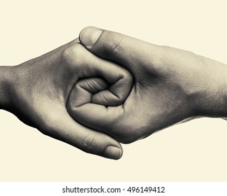 Male and female hands connected with each other  together and forever. This black and white Image is toned and isolated for easy  transfer in your design.