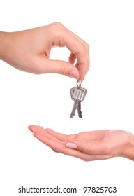male and female hands handing over the keys