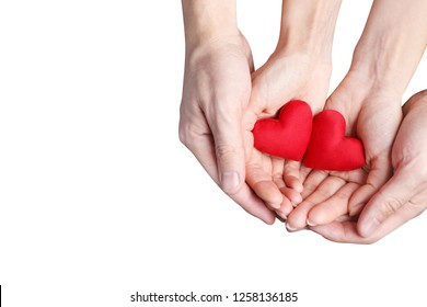 Male and female hands holding two red love hearts, isolated on white background