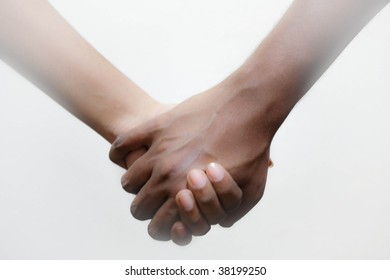 A male and a female holding hands in unity. The sides of the picture giving a misty effect.