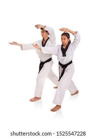 Male and female martial art practitioners using fingertips strike technique, full length portrait on white background