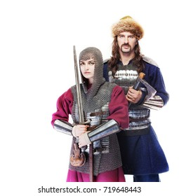 male and female medieval warriors in armour and chain mail, girl warrior in chain mail with sword and man viking in historical suit with ax, Middle Ages