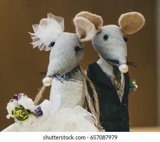 male and female mice wedding toppers for wedding cake. mice  in bride and groom outfit with bouquet