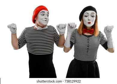 Male and female mimes showing a pantomime, leaning on imaginary walls, expressing emotions without words. Waist up portrait, isolated on white.