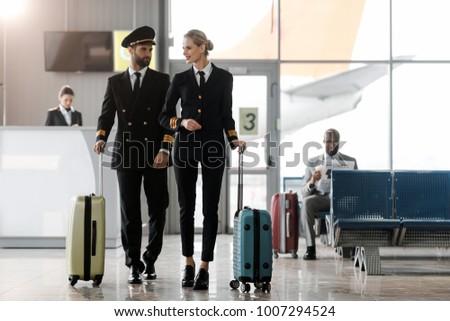 74d591e3b8e Male Female Pilots Walking By Airport Stock Photo (Edit Now ...