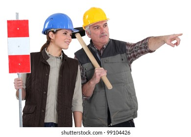 Male and female road workers