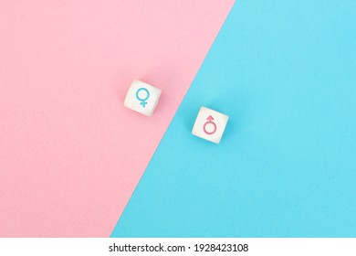 Male and female sex icons on cubes on pink and blue background. Sex change, gender reassignment, transgender and sexual identity concept.
