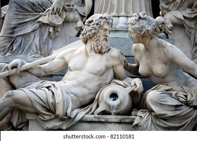 A male and a female statues in the The Athena Fountain (Pallas-Athene-Brunnen) situated in front of the building of Austrian Parliament.