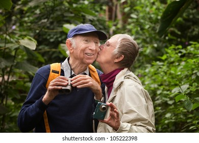 Male and female tourists kissing in the forest