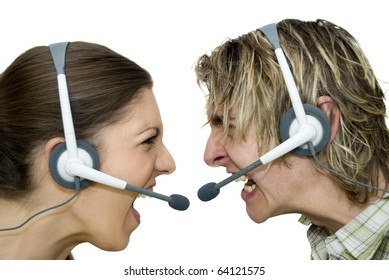Male and female wearing headsets whilst yelling at each other close-up and side on, giving a conceptual feel of business wars. Studio shot against white with copy space.