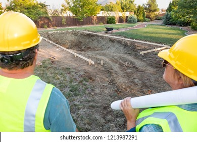 Male and Female Workers Overlooking Pool Construction Site