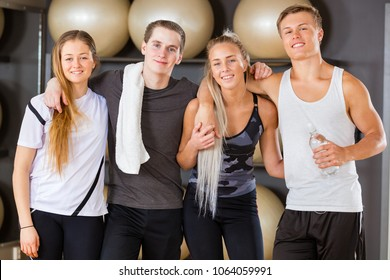 Male And Female Workout Friends Standing Together In Gym