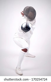 Male fencer isolated in a light background