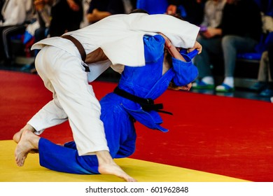 male fighter judoka shoulder throw judo competition