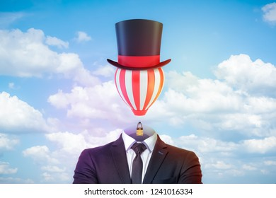 Male figure in smart suit, tie and tophat with a striped hot-air balloon instead of the head against blue sky with white clouds. Ideas change world. Broaden your mind. Creativity and flight of fancy.