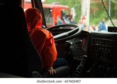 male firefighter sitting in firetruck