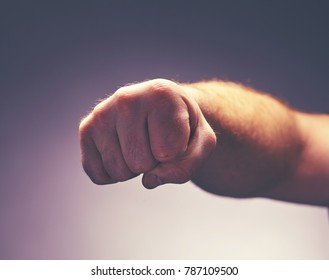 a male fist who wants to hit
