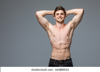 Male fitness model with sexy muscular body portrait handsome hot young man with fit athletic body