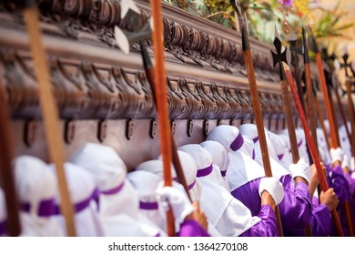 Male float carriers called Cucuruchos, dressed in purple tunicas take in shoulders the image of Jesus in a heavy wooden float during the processions of lent and Holy Week in Antigua Guatemala.