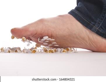 male foot above pushpin