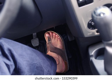 Male foot on the pedal of a car