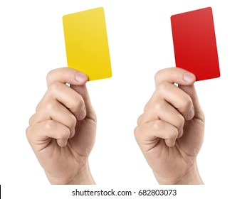 Male football (soccer) referee hand holding yellow and red cards, isolated on white background