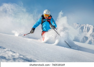 Male freeride skier in the mountains