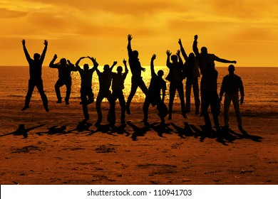 Male friends are having fun at summer and jumping up on the sunset near the sea