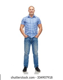 male, gender, fashion and people concept - smiling middle aged man in checkered shirt and jeans