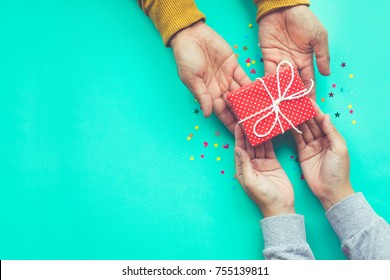 Male gives a gift to female with copy space background.happiness moment concepts ideas