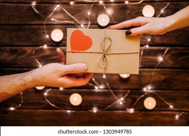 Male gives a gift Valentine's day to female. Happiness  concepts ideas.