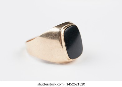Male golden ring with black stone isolated on a white background