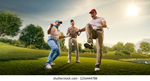 Male golf players on professional golf course. Happy player emotionally rejoices victory. Angry opponent sad about losing and broke his golf club on knee