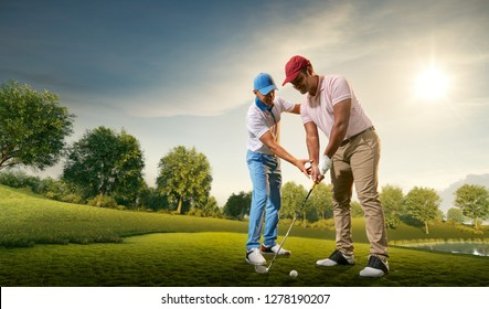 Male golf players on professional golf course. Golfer teaches to play golf