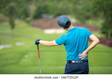 Male golfer has back pain after finish golfing.