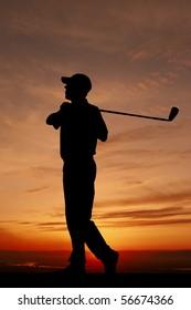 male golfer sunset