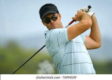 Male golfer tees off during his round