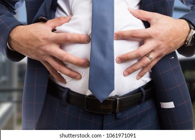 Male grabbing bloated abdomen belly as indigestion constipation bowel or flatulence problem