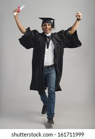 Male graduate cheering with his diploma