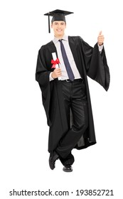 Male graduate holding diploma and giving thumb up isolated on white background