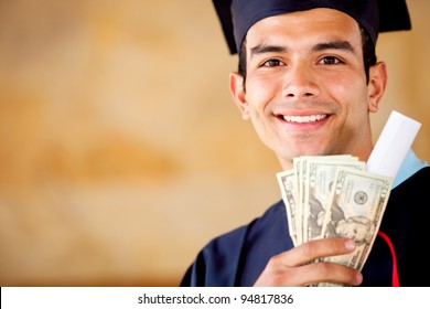 Male graduated holding money - Education costs concepts