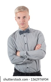 Male in gray shirt and bow-tie standing