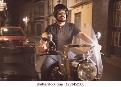 Male guy driving sidecar bike at street