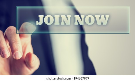 Male hand activating Join now button on virtual screen. Conceptual of social networking.