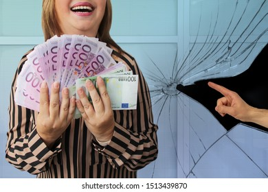male hand against the background of broken glass shows a gesture at a woman who is holding a lot of euro notes in her hands