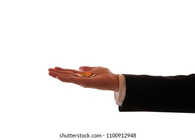 A male hand in a black suit holds a hand with a few coins