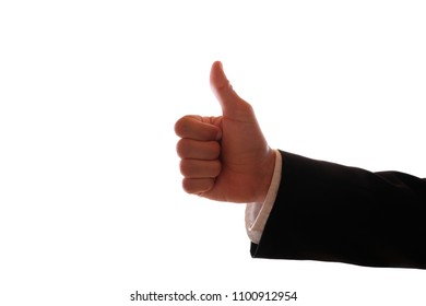 A male hand in a black suit holds his thumb up