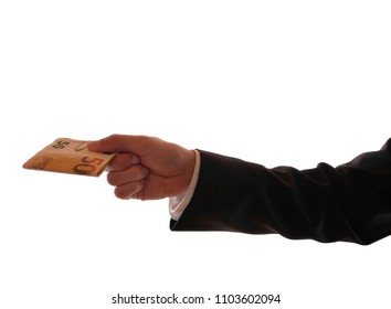 A male hand in a black suit holds out a 50-euro bill