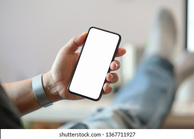 Male hand and blank screen mobile smart phone