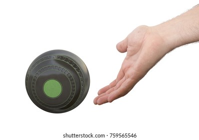 A male hand bowling and releasing a wooden lawn bowling ball on an isolated white  surface -3D render